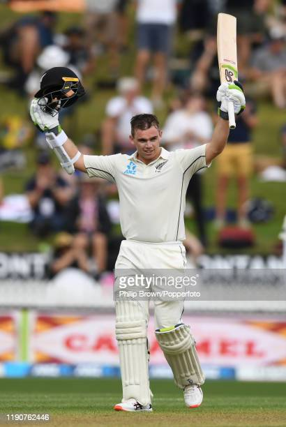Tom Latham of New Zealand celebrates after completing his century during day 1 of the second Test match between New Zealand and England at Seddon...