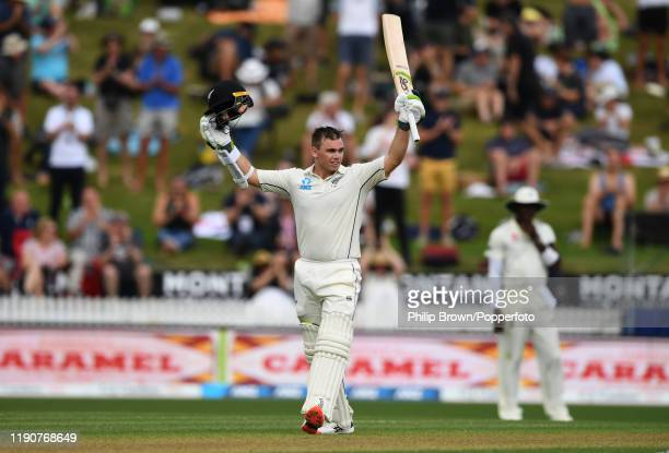 Tom Latham of New Zealand celebrates after reaching his century during day 1 of the second Test match between New Zealand and England at Seddon Park...