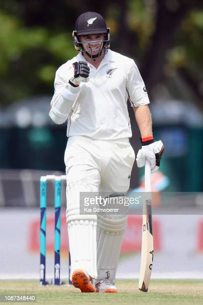 Tom Latham of New Zealand celebrates his century during day three of the Second Test match in the series between New Zealand and Sri Lanka at Hagley...
