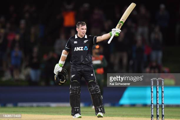 Tom Latham of New Zealand celebrates his century during game two of the One Day International series between New Zealand and Bangladesh at Hagley...