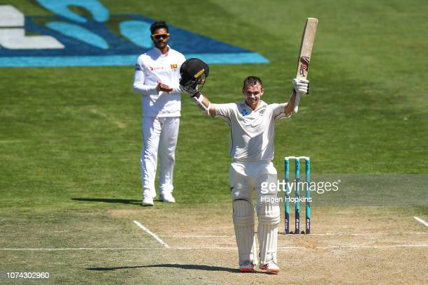 Tom Latham of New Zealand celebrates his double century during day three of the First Test match in the series between New Zealand and Sri Lanka at...