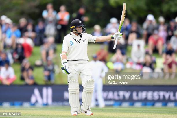 Tom Latham of New Zealand celebrates his half century during day three of the Second Test match between New Zealand and India at Hagley Oval on March...