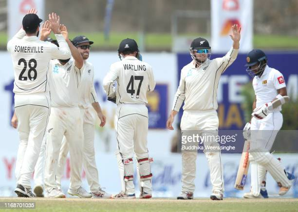 Tom Latham of New Zealand celebrates with his teammates after the dismissal of Kusal Mendis of Sri Lanka during day five of the First Test match...