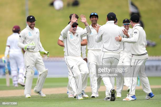 Tom Latham of New Zealand congratulates Ross Taylor after taking a catch to dismiss Sunil Ambris of the West Indies during day four of the Test match...