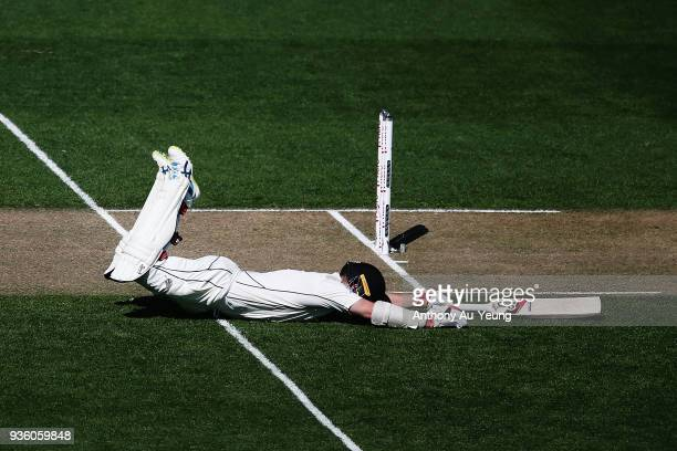 Tom Latham of New Zealand dives to the crease during day one of the First Test match between New Zealand and England at Eden Park on March 22, 2018...