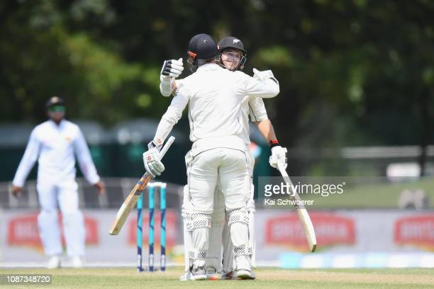 Tom Latham of New Zealand is congratulated by Henry Nicholls of New Zealand after scoring his century during day three of the Second Test match in...