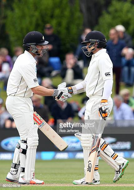 Tom Latham of New Zealand is congratulated by Kane Williamson after scoring 50 runs during day three of the First Test match between New Zealand and...