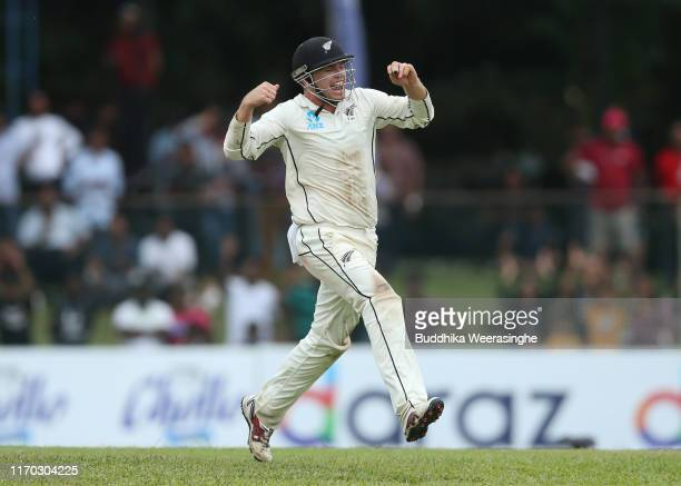 Tom Latham of New Zealand leaps into air celebrate to taking wicket of Niroshan Dickwella during the day five of the Second Test match between Sri...