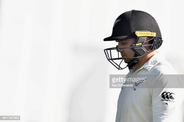 Tom Latham of New Zealand looks dejected after being dismissed by Jack Leach of England during day five of the Second Test match between New Zealand...