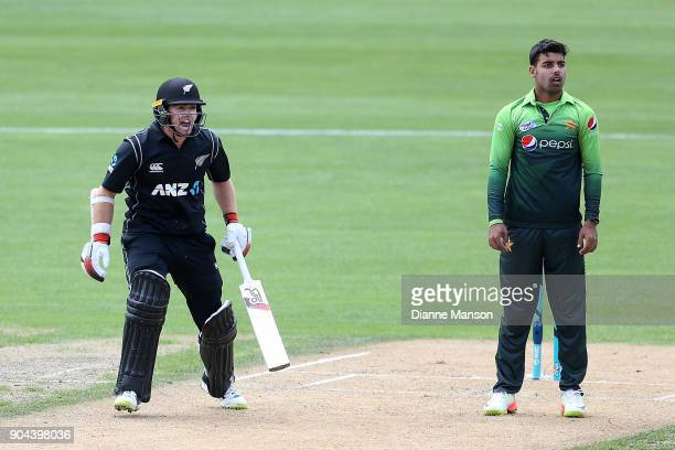 Tom Latham of New Zealand reacts as Shadab Khan of Pakistan looks on during the third game of the One Day International Series between New Zealand...