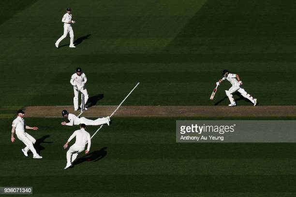 Tom Latham of New Zealand runs back to his crease during day one of the First Test match between New Zealand and England at Eden Park on March 22...