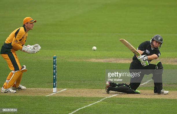 Tom Latham of New Zealand sweeps the ball in front of wicketkeeper Tom Triffitt of Australia during the ICC U19 Cricket World Cup quarter final three...