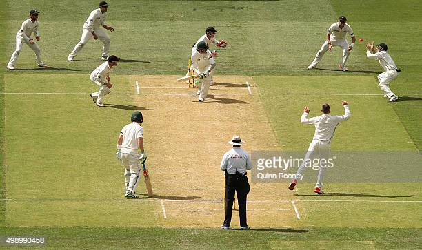 Tom Latham of New Zealand takes a catch to dismiss Peter Siddle of Australia off the bowling of Mark Craig of New Zealand during day two of the Third...
