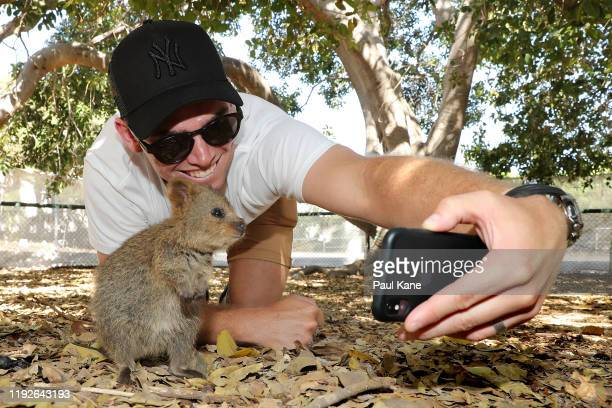 Tom Latham of the New Zealand Test team takes a selfie with a Quokka during a visit to Rottnest Island on December 08, 2019 in Perth, Australia.