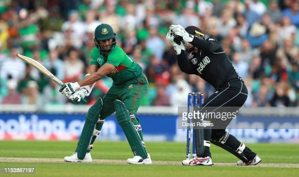 Tom Latham the New Zealand wicket keeper takes the ball as Shakib Al Hasan plays and misses during the Group Stage match of the ICC Cricket World Cup...