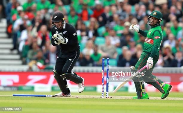 Tom Latham the New Zealand wicketkeeper runs out Mushfiqur Rahim during the Group Stage match of the ICC Cricket World Cup 2019 between Bangladesh...