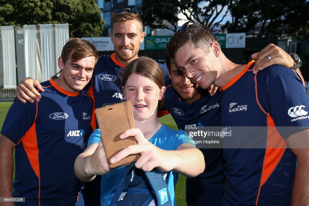 Tom Latham, Tim Southee, Mitchell Santner and Ross Taylor pose for a selfie with thirteen-year-old Erin Buckland who is 'flying the flag' for females in cricket during the ANZ Dream Deliveries programme at Basin Reserve on February 23, 2017 in Wellington, New Zealand.