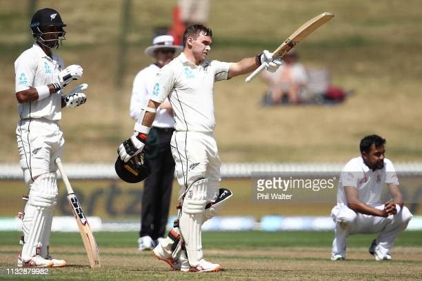 Tom Lathlam of new Zealand celebrates his century during day two of the First Test match in the series between New Zealand and Bangladesh at Seddon...