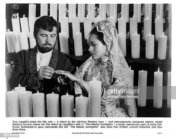 Tom Laughlin puts ring on Barbara Carrera in a scene from the film 'The Master Gunfighter', 1975.