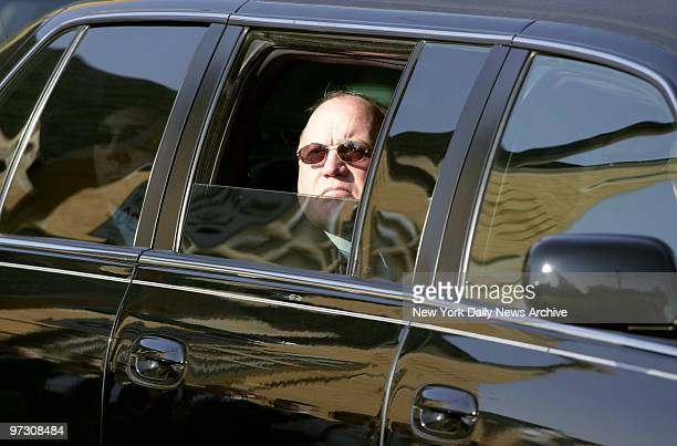 Tom Lawler peers out the window of a limousine after funeral services for his wife, Kathleen, and son, Christopher, at St. Francis DeSales Church....