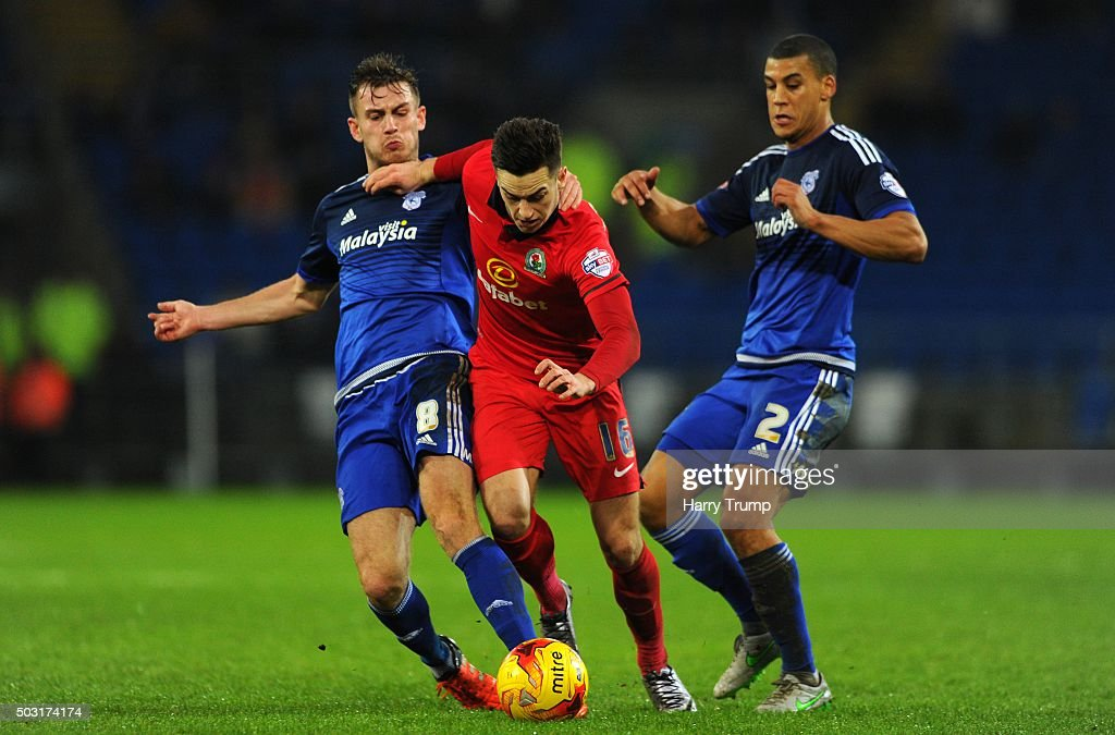Tom Lawrence of Blackburn Rovers is tackled by Joe Ralls of Cardiff City during the Sky Bet Championship match between Cardiff City and Blackburn Rovers at the Cardiff City Stadium on January 2, 2016 in Cardiff, Wales.