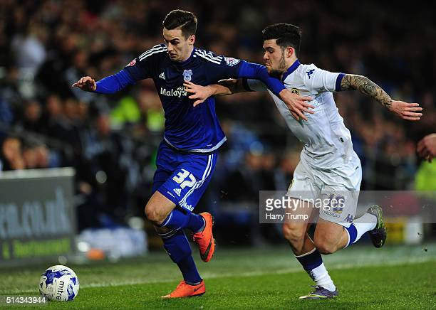 Tom Lawrence of Cardiff City is tackled by Alex Mowatt of Leeds United during the Sky Bet Championship match between Cardiff City and Leeds United at...