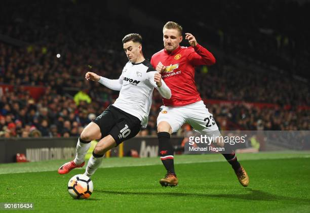 Tom Lawrence of Derby County and Luke Shaw of Manchester United battle for the ball during the Emirates FA Cup Third Round match between Manchester...