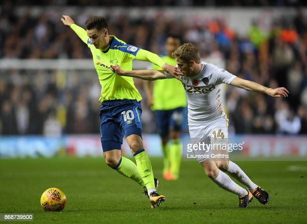 Tom Lawrence of Derby County battles for the ball with Eunan O'Kane of Leeds United during the Sky Bet Championship match between Leeds United and...