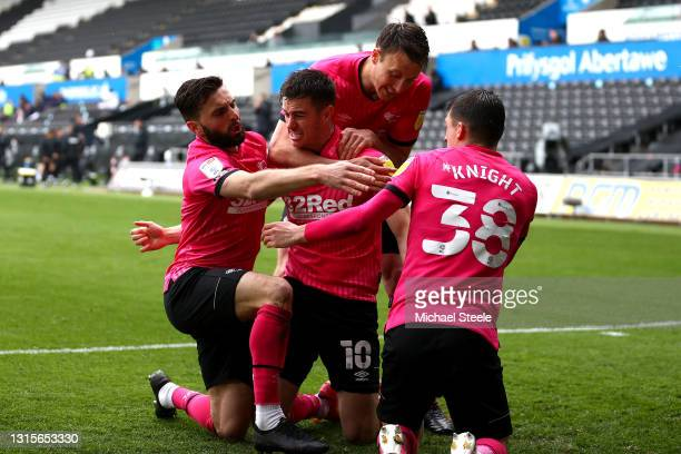 Tom Lawrence of Derby County celebrates with Graeme Shinnie and Jason Knight after scoring their team's first goal during the Sky Bet Championship...