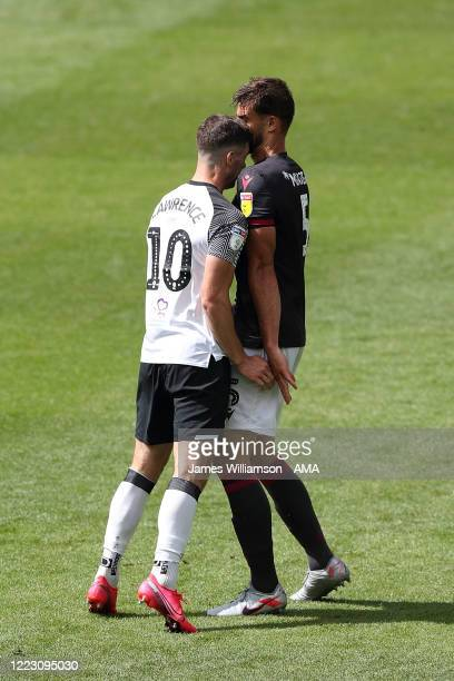 Tom Lawrence of Derby County clashes with Matt Miazga of Reading at full time of the Sky Bet Championship match between Derby County and Reading at...