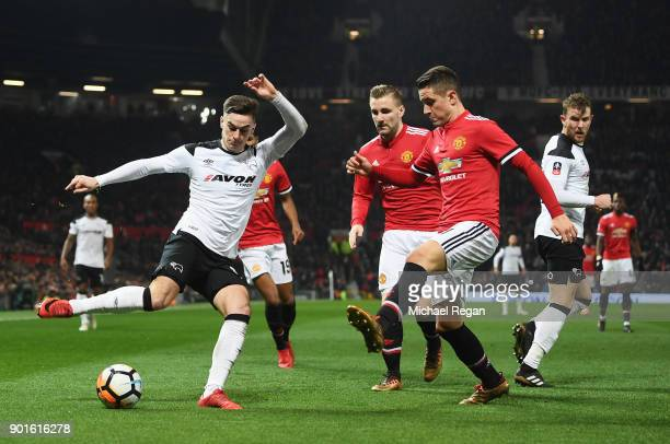 Tom Lawrence of Derby County is faced by Ander Herrera of Manchester United during the Emirates FA Cup Third Round match between Manchester United...