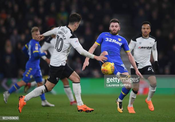 Tom Lawrence of Derby County is tackled by Stuart Dallas of Leeds United during the Sky Bet Championship match between Derby County and Leeds United...