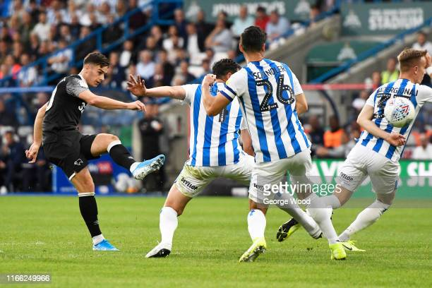 Tom Lawrence of Derby County scores his teams second goal of the match during the Sky Bet Championship match between Huddersfield Town and Derby...