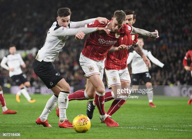 Tom Lawrence of Derby tackles Aden Flint of Bristol City during the Sky Bet Championship match between Derby County and Bristol City at the iPro...