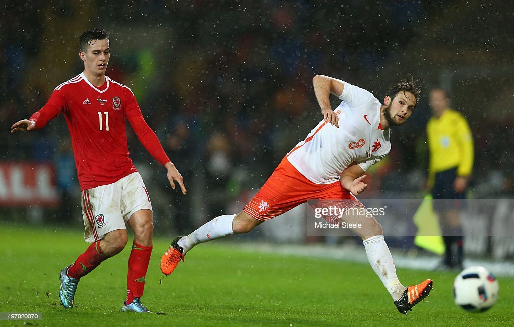 Tom Lawrence (L) of Wales alongside Danny Blind (R) of Netherlands during the international friendly match between Wales and Netherlands at Cardiff City Stadium on November 13, 2015 in Cardiff, Wales.