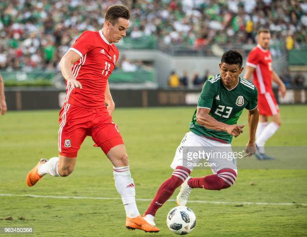 Tom Lawrence of Wales and Erick Guitierrez of Mexico during the international friendly match between Mexico and Wales at the Rose Bowl on May 28 2018...