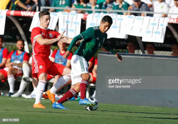 Tom Lawrence of Wales battles Hugo Ayala of Mexico for the ball during the game on May 28 at the Rose Bowl in Pasadena CA