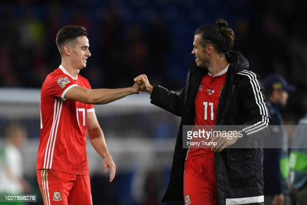 Tom Lawrence of Wales celebrates with Gareth Bale of Wales after the UEFA Nations League B group four match between Wales and Republic of Ireland at...