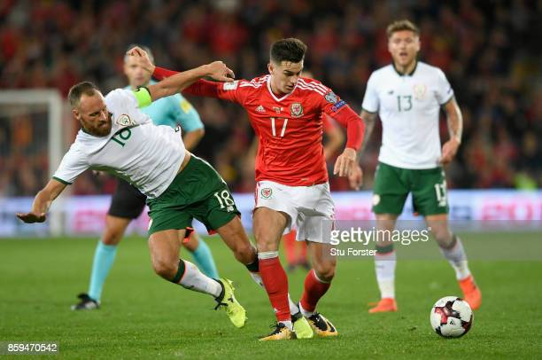 Tom Lawrence of Wales holds off David Meyler of the Republic of Ireland during the FIFA 2018 World Cup Group D Qualifier between Wales and Republic...