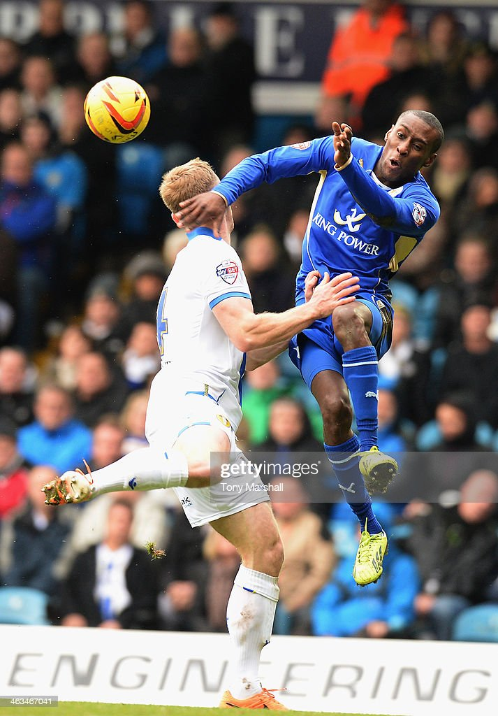 Tom Lees of Leeds United challenges Lloyd Dyer of Leicester City in the air during the Sky Bet Championship match between Leeds United and Leicester City at Elland Road on January 18, 2014 in Leeds, England,