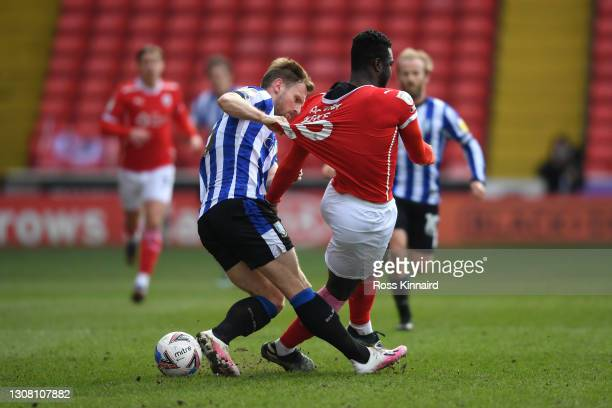 Tom Lees of Sheffield Wednesday and Daryl Dike of Barnsley FC battle for the ball during the Sky Bet Championship match between Barnsley and...