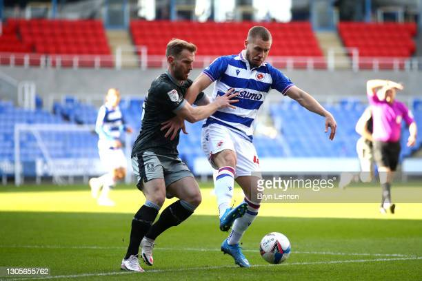 Tom Lees of Sheffield Wednesday and George Puscas of Reading FC battle for the ball during the Sky Bet Championship match between Reading and...