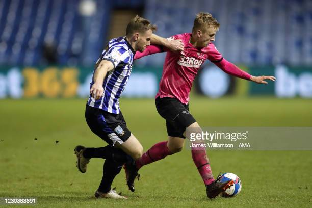Tom Lees of Sheffield Wednesday and Louie Sibley of Derby County during the Sky Bet Championship match between Sheffield Wednesday and Derby County...