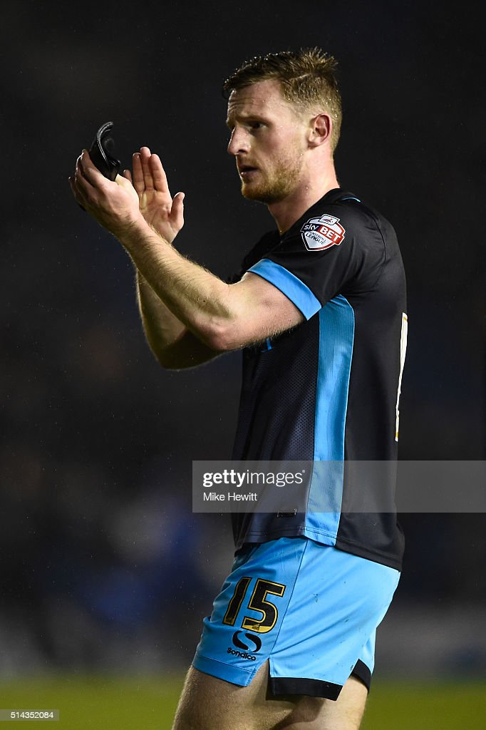 Tom Lees of Sheffield Wednesday applauds the travelling fans at the end of the Sky Bet Championship match between Brighton and Hove Albion and Sheffield Wednesday at the Amex Stadium on March 8, 2016 in Brighton, United Kingdom.
