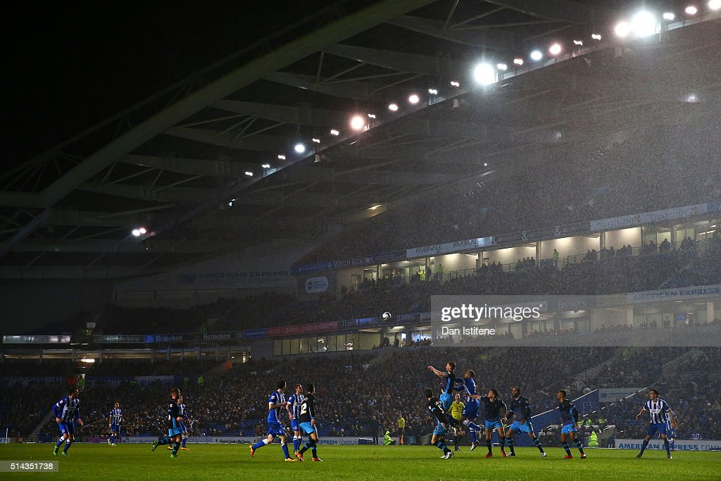 Tom Lees of Sheffield Wednesday jumps for the ball with Bobby Zamora of Brighton and Hove Albion as rain falls during the Sky Bet Championship match between Brighton and Hove Albion and Sheffield Wednesday at Amex Stadium on March 8, 2016 in Brighton, United Kingdom.