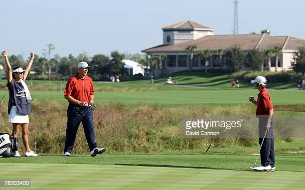 Tom Lehman celebrates with his wife Melissa Lehman as they watch his son Thomas Lehman make a long biride putt at the 1st hole during the first round...