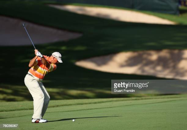 Tom Lehman hits a shot on the 12th hole during the first round of the 89th PGA Championship at the Southern Hills Country Club on August 9 2007 in...