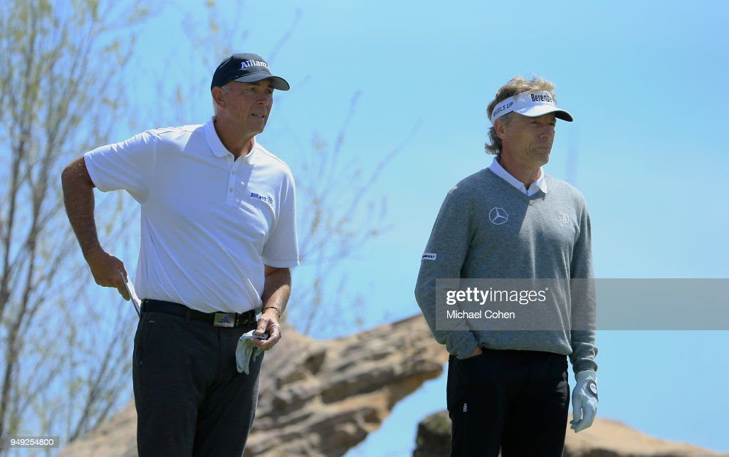 Tom Lehman of the United States (L) and team mate Bernhard Langer of Germany look on during the second round of the PGA TOUR Champions Bass Pro Shops Legends of Golf at Big Cedar Lodge held at Top of the Rock on April 20, 2018 in Ridgedale, Missouri.