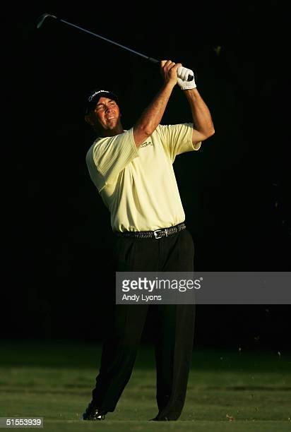 Tom Lehman watches his second shot on the par-4 18th hole during the third round of the Funai Classic on October 23, 2004 at the Walt Disney World...