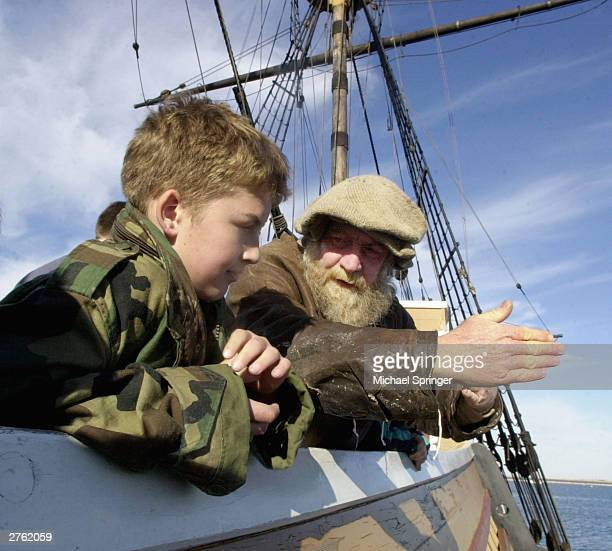 Tom Lehy portraying Seaman Wood explains life aboard The Mayflower II to 11yearold Christopher Kennedy November 25 2003 in Plymouth Massachusetts The...